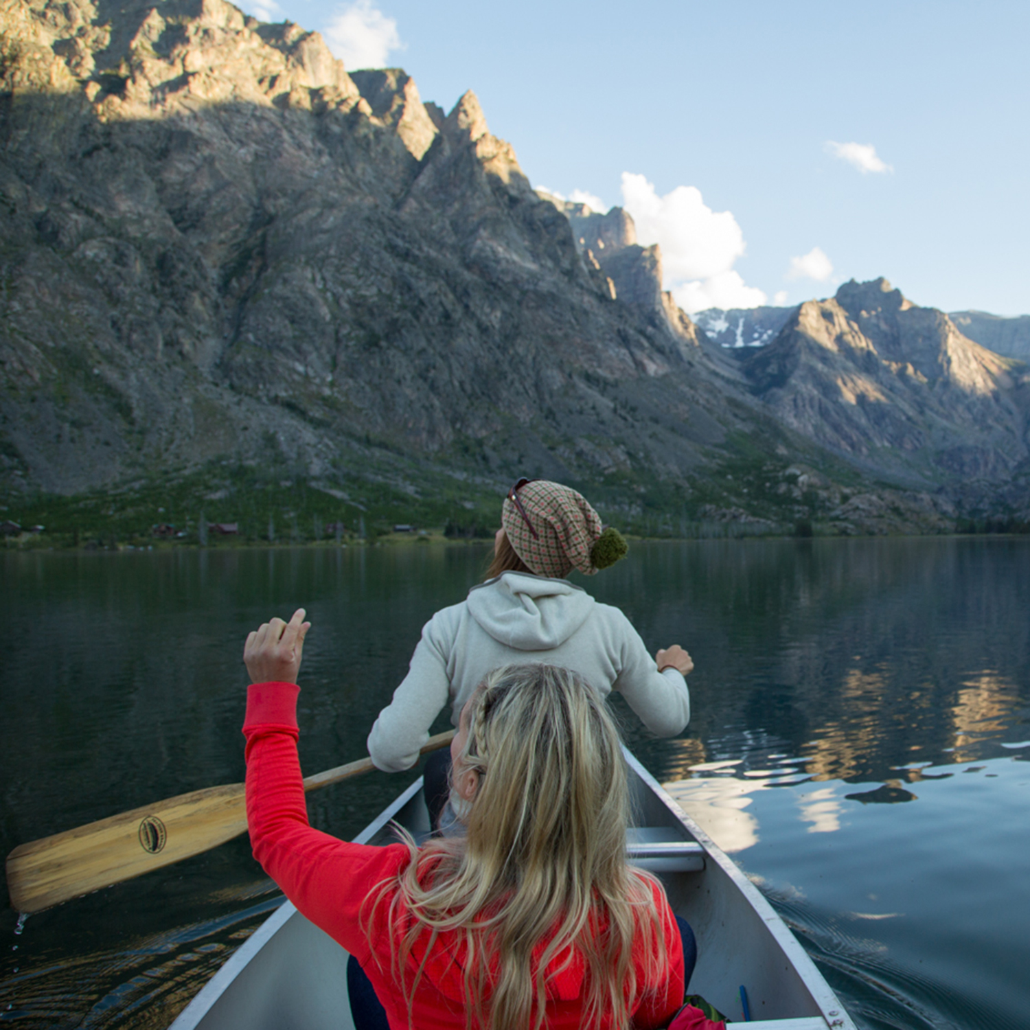"""""""Scoping lines from the canoe with Caroline Gleich & Lydia Tanner. These mountains make you feel small...nothing like water to re-set the mind + a little glass to inspire. I believe it's in these environments that creativity thrives. It's such a treat to share with others and watch their eyes glow, a flame, a spark, which nature provides. Food for the soul."""""""