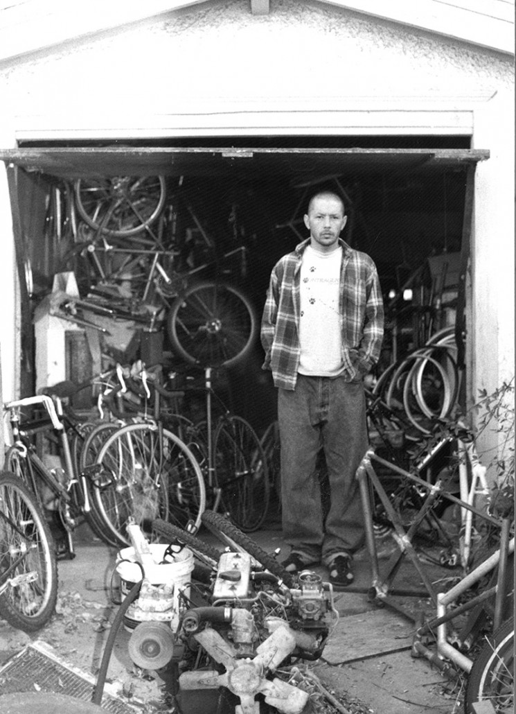 The image that said it all--no glitz, no shiny, day-glo bikes, no roster of famous pro riders...just a man who built a lot of frames and paid keen attention to the little details that actually mattered. Keith Bontrager stands in front of his Santa Cruz, California garage.
